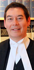 Michael Mark, personal injury, icbc claims lawyer 25 years experience in civil litigation wearing trial robes in photo